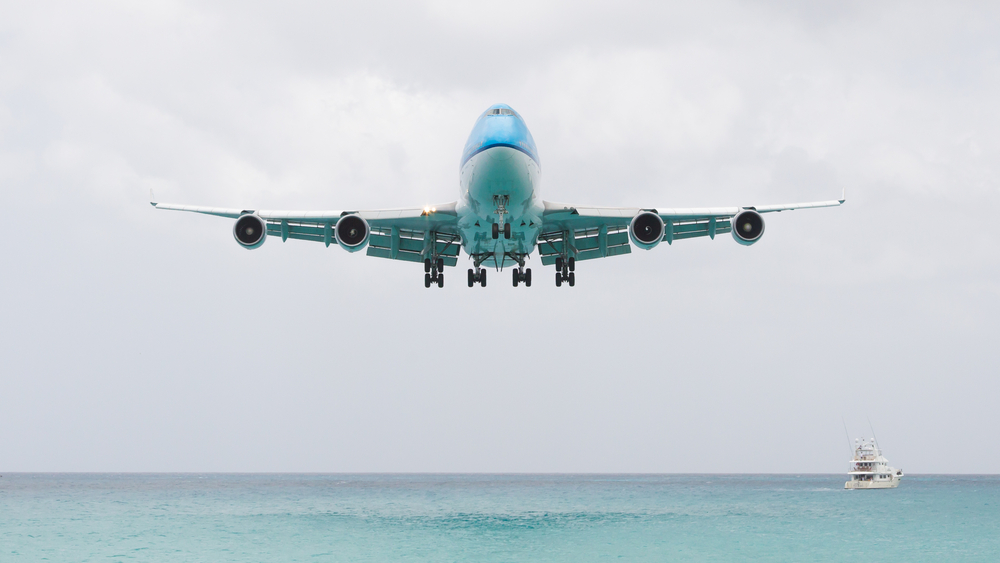 Watching Airplane over Ocean from Port - Shore Excursions Group