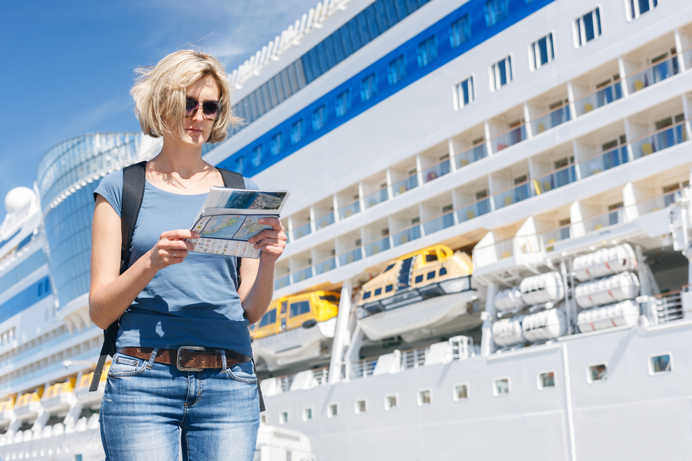 Tourist with map, first time cruiser - Shore Excursions Group